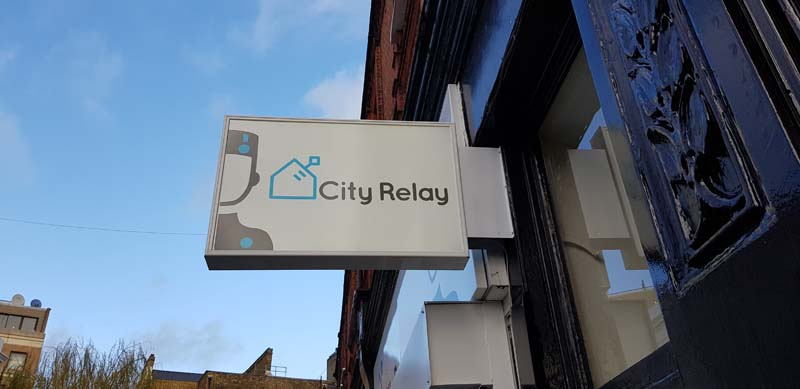 Illuminated Projecting Sign for City Relay