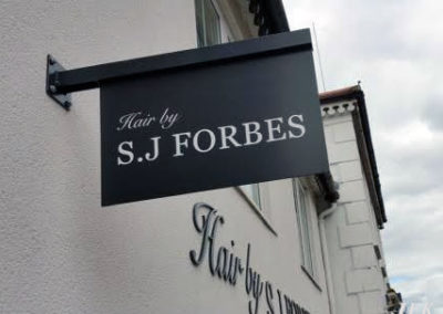 Projecting Signs for Sj Forbes