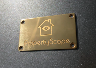 Small brass plaque - Property Scope