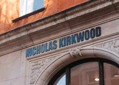 Laser-cut raised lettered signage for Nicolas Kirkwood