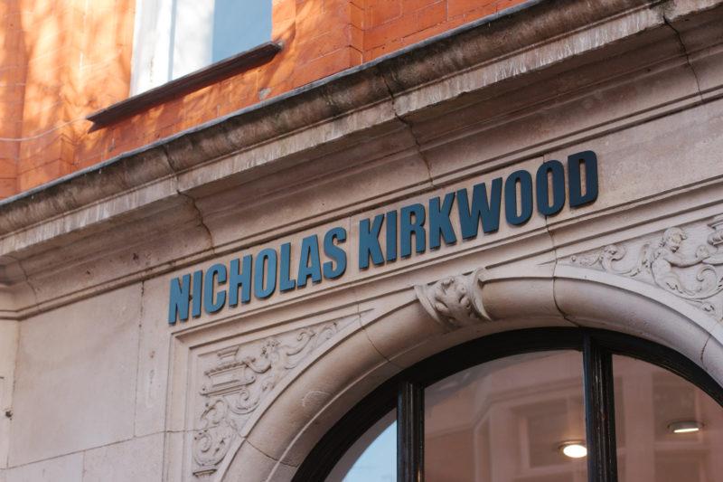 Laser-cut raised lettered signage for Nicolas Kirkwood