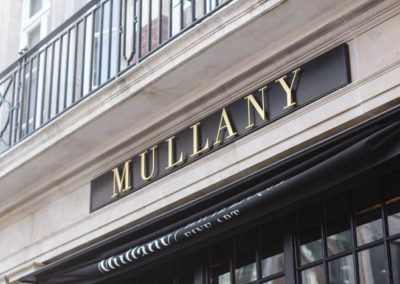 Elevated brass fascia signage for Mullany