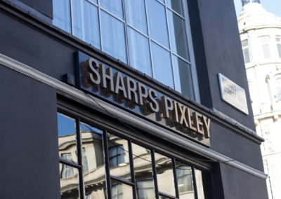 Built Up Patinated Brass Fascia Signage for Sharps Pixley