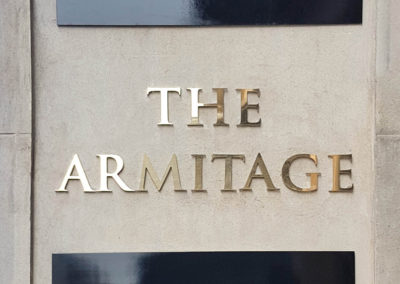 Reverse-etched brass fascia signage for The Armitage