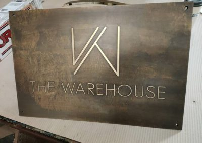 3mm thick reverse etched, bronze toned brass plate for The Warehouse
